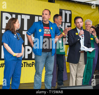 London, UK. 23rd Mar, 2019. Head of BMA Chaand Nagpaul, with nurses addressing the People's Vote March and rally, 'Put it to the People.' Credit: Prixpics/Alamy Live News - Stock Image