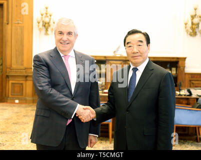 Bucharest, Romania. 23rd Apr, 2019. Romanian Senate President Calin Popescu-Tariceanu (L) shakes hands with Zhang Qingli, vice chairman of the National Committee of the Chinese People's Political Consultative Conference (CPPCC), in Bucharest, Romania, April 23, 2019. Zhang led a delegation of Chinese political advisors for a visit here. Credit: Chen Jin/Xinhua/Alamy Live News - Stock Image
