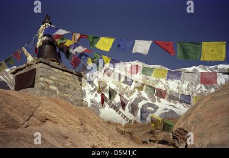 Prayer flags and monument near Annapurna Base Camp with Annapurna I 8091 metres Nepal Himalayas - Stock Image
