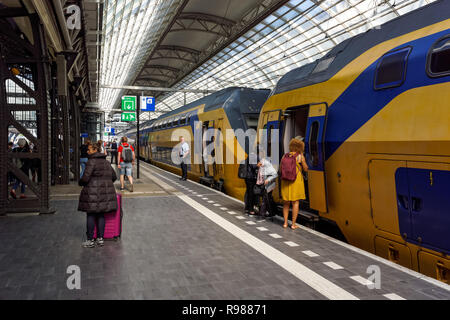Train at Amsterdam Centraal, Amsterdam Central Station, Amsterdam, Netherlands - Stock Image