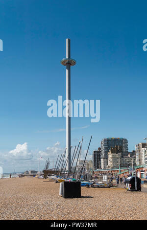 British Airways i360 observation tower and beach on Brighton seafront, East Sussex, England, UK - Stock Image
