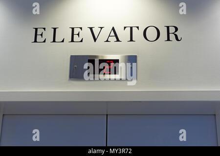 Elevator sign and digital floor indicator - Stock Image
