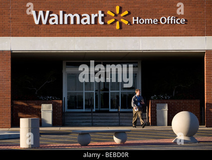 A worker exits the entrance to Walmart Stores Inc.'s Home Office in Bentonville, Ark. (Sept. 2009) - Stock Image
