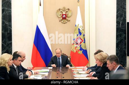 Russian President Vladimir Putin, center, during a meeting with senior government officials at the Kremlin January 30, 2019 in Moscow, Russia. - Stock Image