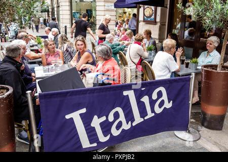 London England United Kingdom Great Britain Soho Bella Italia restaurant Italian alfresco dining sidewalk seating tables man woman - Stock Image