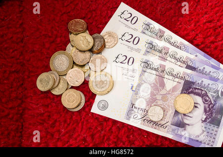 UK British currency notes and coins - Stock Image