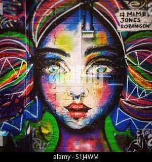 Street art of girls face - Stock Image