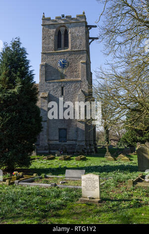The tower of the church of St John the Baptist in the village of Chelveston, Northamptonshire, UK - Stock Image