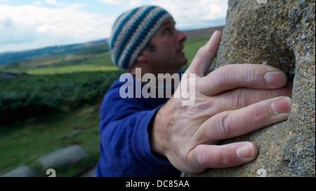 rock climber bouldering at Burbage Edge South, Derbyshire, Peak District National Park, England, UK, United, Kingdom, - Stock Image
