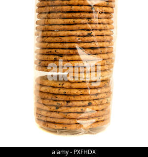 'The Odd One Out' A packet of clear cellophane wrapped biscuits with one faulty folded cracker illustrating a problem or failure in quality control. - Stock Image