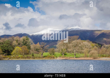 Derwentwater in spring with snow on Skiddaw, Cumbria, UK. - Stock Image