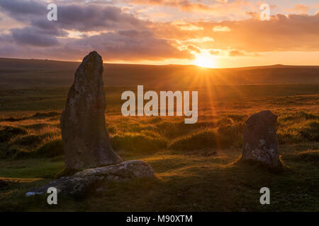 Sunset over the megalithic standing stones of Scorhill stone circle, Dartmoor, Devon, England. Summer (August) 2017. - Stock Image