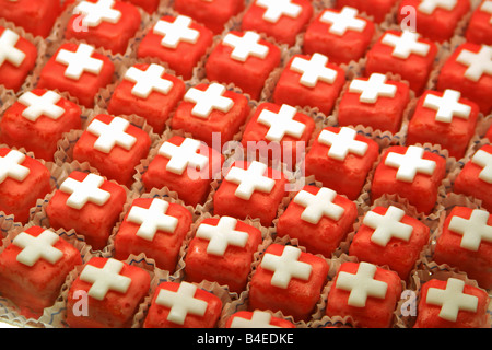 Switzerland Zurich Pralines with swiss white cross for 1 August National day - Stock Image