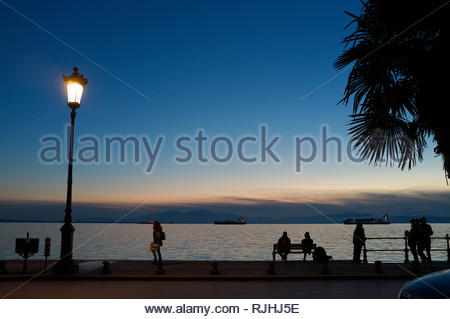 Winter sunset by the waterfront in the city of Thessaloniki, Central Macedonia, Greece. - Stock Image