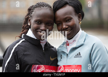 London,UK,25th April 2019,Vivian Cheruiyot(Ken) and Mary Keitany(Ken) attend The London Marathon Elite Women's Photocall takes place outside the Tower Hotel with Tower Bridge in the background ahead of the Marathon on Sunday.Credit: Keith Larby/Alamy Live News - Stock Image