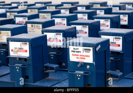 Rows of surplus newspaper boxes sit in an alley behind a building in Rogers, Ark. - Stock Image