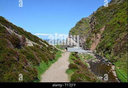 Route beside the stream, to the beach through Heddon Valley, coast, Devon, UK - Stock Image