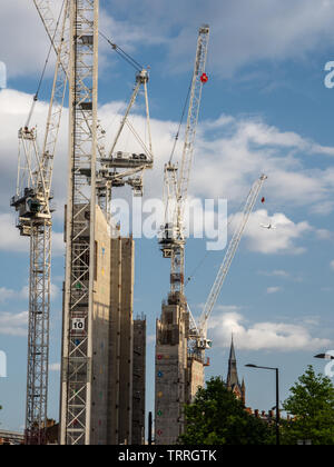 London, England, UK - June 3, 2019: Tower cranes cluster around the concrete core of the new Google UK HQ 'groundscraper' office building in King's Cr - Stock Image