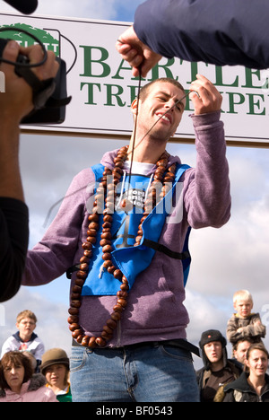 Disappointed BBC Blue Peter TV presenter Joel Defries looses his nut while competing at the 45th World Conker Championships - Stock Image