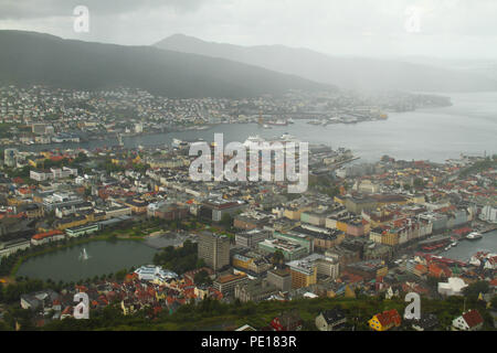 Bergen, Norway - 9 August 2018: The city of Bergen, Norway's second largest city see from 320meters at the summit of Mount Floien.  The city was for many years the centre of trade between Norway and the rest of Europe and is now usually the starting point to  expeditions into the country. The 900-year-old city steams its roots from the Viking age,  with Bryggen (The Hanseatic Wharf) being a remnant from this times and it today home to many of the cities restaurants, pubs, craft shops and museums. Photo: David Mbiyu - Stock Image
