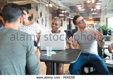 Colleagues talking at table - Stock Image
