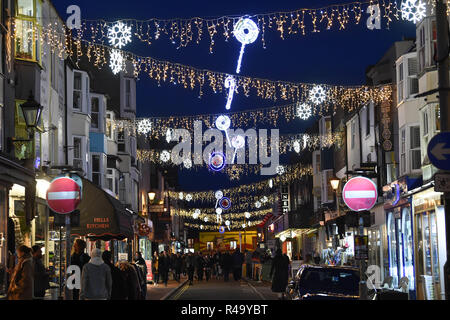 Brighton UK 26th November 2018 - Shoppers out in force in Brighton late this afternoon as Christmas shopping gets in full swing amongst the lights Credit: Simon Dack/Alamy Live News - Stock Image