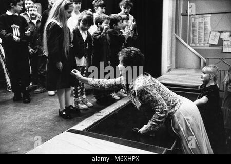 Children lined up on stage at small eisteddfod in village hall at Y Groeslon Gwynedd North Wales UK - Stock Image