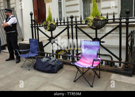 London, UK. 17th June 2019. Richard Ratcliffe on hunger strike in front of the Iranian embassy in London in protest of the detention of his wife Nazanin Zgahari in Iran over spying allegations. Two chairs and a bag have now been moved as embassy staff and builders want to go ahead with pressure cleaning of the front of the building. Credit: Joe Kuis / Alamy - Stock Image