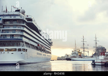 Ferry in port at dusk - Stock Image