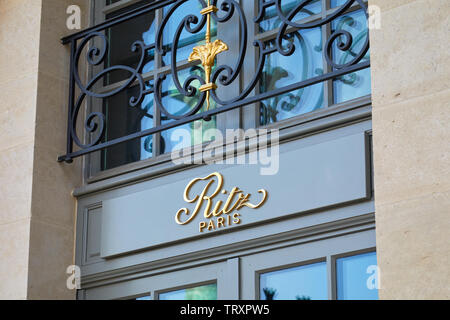 PARIS, FRANCE - JULY 21, 2017: Ritz, luxury hotel golden sign in place Vendome in Paris, France. - Stock Image