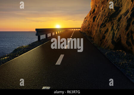 Danger cliff road. High rock mountain above the blue sea under the sunset. - Stock Image