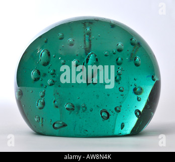 A Victorian antique old green glass dump paperweight - Stock Image