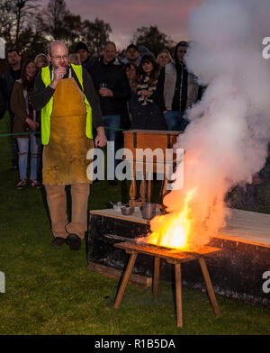 Historian Mark Griffin demonstrates the alchemy of gunpowder to onlookers at leeds castle. - Stock Image