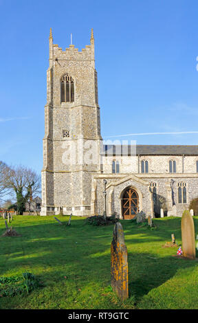 A view of the tower and south porch of the parish Church of St Mary the Virgin at Northrepps, Norfolk, England, United Kingdom, Europe. - Stock Image