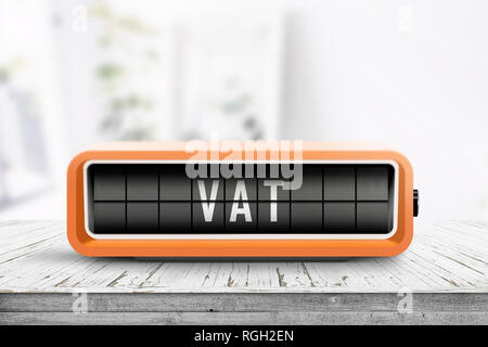 VAT tax sign in form of a retro alarm clock on a wooden table in a bright room - Stock Image