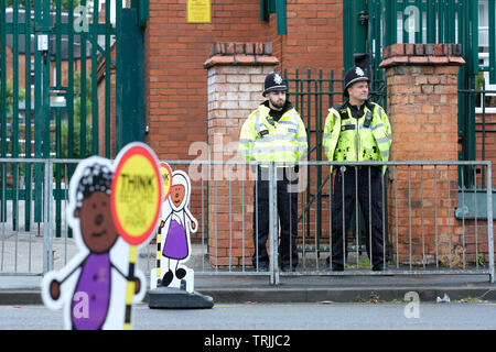 Birmingham, UK - Friday 7th June 2019 - Police stand guard outside the Anderton Park Primary School in Birmingham as a protest is due this afternoon. A High Court injunction is in force to prevent protesters gathering directly outside the school. Photo Steven May / Alamy Live News - Stock Image