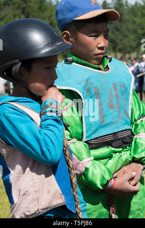 Naadam Festival in Khatgal, Mongolia.. Two young horse riders after the race - Stock Image