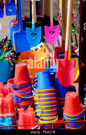 Multicoloured seaside toys and buckets and spades for sale in a shop - Stock Image