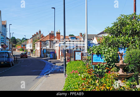 A view of the A149 road passing through the North Norfolk coastal village of East Runton, Norfolk, England, United Kingdom, Europe. - Stock Image
