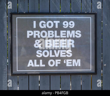 Sign saying - I got 99 problems and beer solves all of them. Outside the Devon & Cornwall pub, Millbrook, Cornwall. - Stock Image