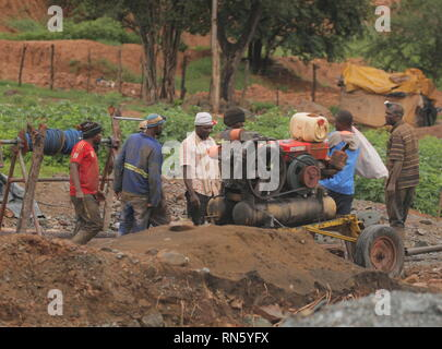 Mashonaland West, Zimbabwe. 16th Feb, 2019. Rescuers start a generator at a mine in Battlefields, Mashonaland West Province, Zimbabwe, Feb. 16, 2019. Eleven illegal miners were rescued Saturday after being trapped in a gold mine in Zimbabwe's Mashonaland West Province. So far, 24 bodies have been retrieved as rescuers continue to search for survivors. Credit: Shaun Jusa/Xinhua/Alamy Live News - Stock Image