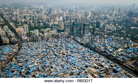 Mumbai. AMAZING aerial images have captured the stark contrast and inequality where rich meets poor all across the world. The spectacular bird's eye view pictures show the landscape as an affluent area gives way onto one where people may be suffering from poverty. The stunning shots show this crossover of the rich and poor all across South Africa, Kenya, Mexico and even the USA. The remarkable photographs form of africanDRONE founder and photographer Johnny Miller's (37) Unequal Scenes project. Johnny Miller / mediadrumimages.com - Stock Image
