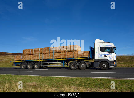 Bannerman Company Limited HGV with load of bark products. M6 motorway Southbound carriageway, Shap, Cumbria, England, United Kingdom, Europe. - Stock Image