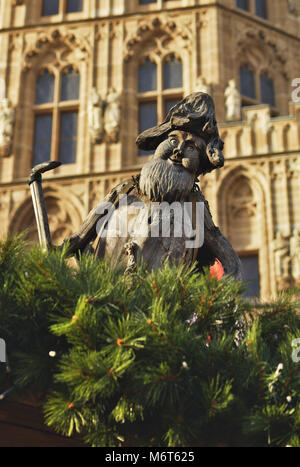 Gnome in front of the historical council building in Cologne - Stock Image