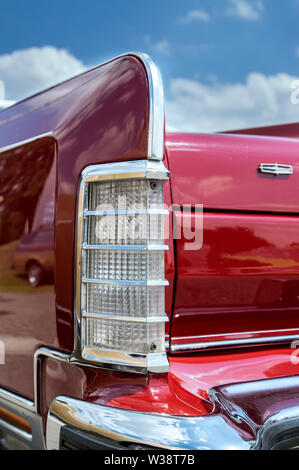 Detail of the rear of a red vintage Lincoln Continental car - Stock Image