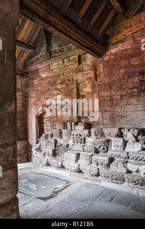 Hereford Cathedral, UK. A stack of old medieval carved stone capitals, saved after the collapse of the west front in 1786 - Stock Image