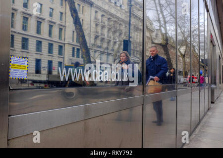 London, UK. 23 Feb, 2019. People walk past the offices of the  Civil Aviation Authority (CAA), which regulates civil aviation in the UK, in February 2 - Stock Image