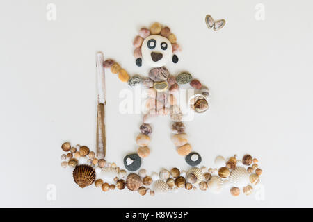 natural art, craft, picture of person surfing or paddle-boarding, made from pebbles, shells, - Stock Image
