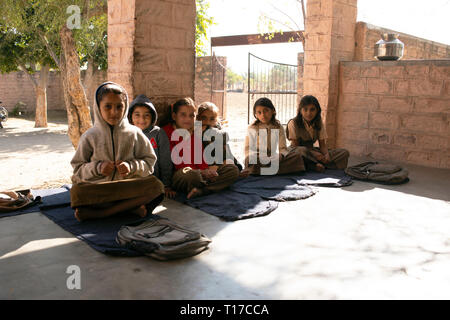 Bishnoi school girls wait for the boys to arrive at their village school so that the lessons can begin. - Stock Image