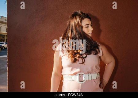 One woman looking to the side. - Stock Image